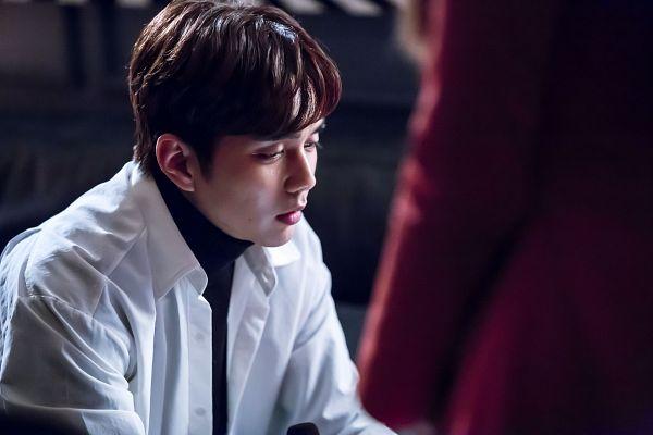 Tags: K-Drama, Yoo Seung-ho, Collar (Clothes), Black Shirt, Sad, Bent Knees, Turtleneck, Sitting, I'm Not a Robot