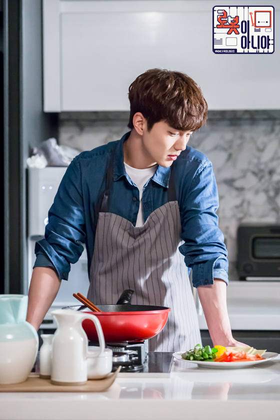 Tags: K-Drama, Yoo Seung-ho, Blue Shirt, Microwave, Text: URL, Food, Vegetables, Apron, Kitchen, Text: Series Name, I'm Not a Robot