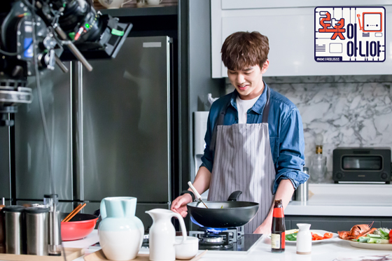 Tags: K-Drama, Yoo Seung-ho, Fire, Text: Series Name, Microwave, Text: URL, Blue Shirt, Food, Fridge, Apron, Kitchen, I'm Not a Robot