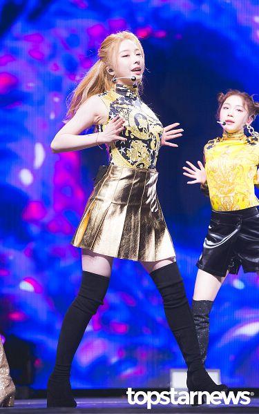 Tags: K-Pop, Rocket Punch, Yunkyoung, Bare Shoulders, Black Legwear, Sleeveless, Yellow Skirt, Yellow Shirt, Sleeveless Shirt, Skirt, Pleated Skirt, Blue Background