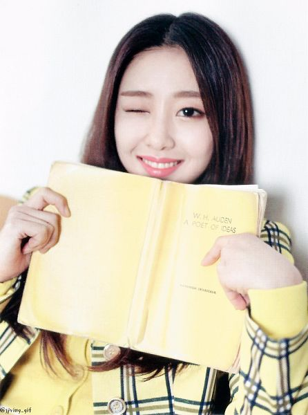 Tags: K-Pop, LOOΠΔ, New, Yves, Wink, Yellow Outerwear, Holding Object, Leaning On Wall, Close Up, Open Book, Book, Wall