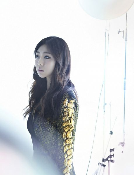 Tags: K-Pop, Ladies Code, Zuny, Looking Away, Text: Magazine Name, Gold Jacket, Light Background, White Background, Him