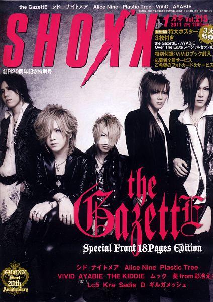 Tags: J-Pop, the GazettE, Reita (the GazettE), Aoi (the GazettE), Uruha (the GazettE), Ruki (the GazettE), Kai (the GazettE), Leather Jacket, Black Pants, Japanese Text, Text: Artist Name, Blonde Hair