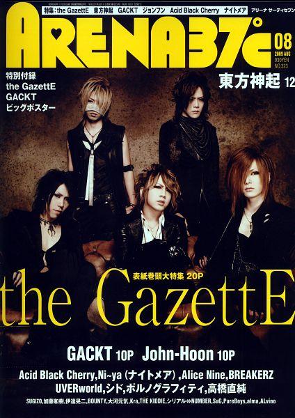 Tags: J-Pop, the GazettE, Aoi (the GazettE), Uruha (the GazettE), Ruki (the GazettE), Kai (the GazettE), Reita (the GazettE), Sitting On Couch, Couch, Text: Magazine Name, Black Pants, Black Shirt